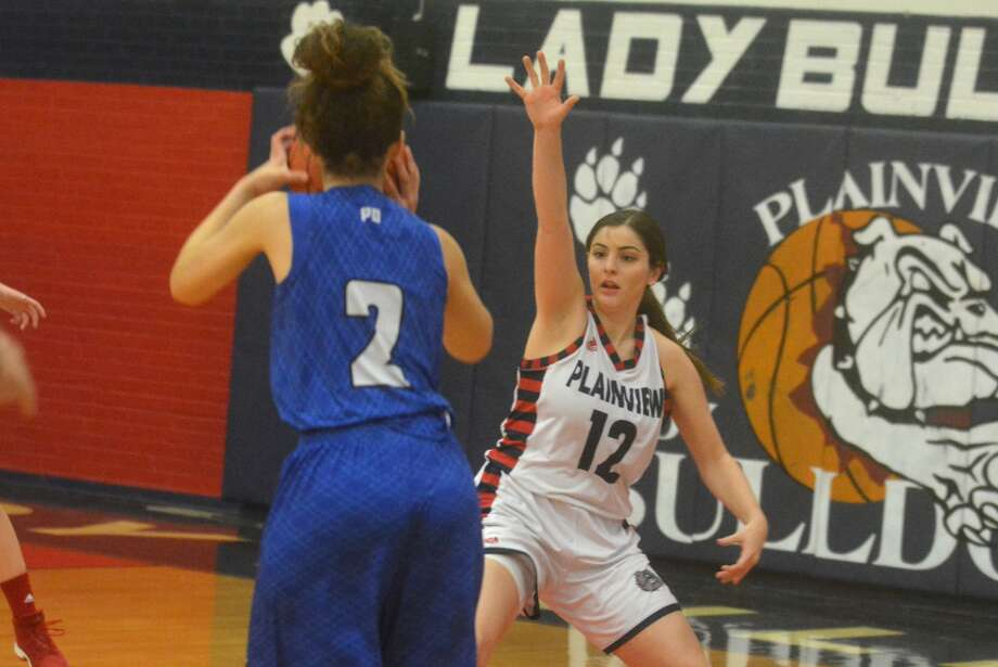 Plainview's Lauren Pritchard, 12, plays defense against Palo Duro in a game earlier this season. The 5-foot-6 senior post is an essential part of the Lady Bulldog team with her contributions both on and off the court. Photo: Skip Leon/Plainview Herald