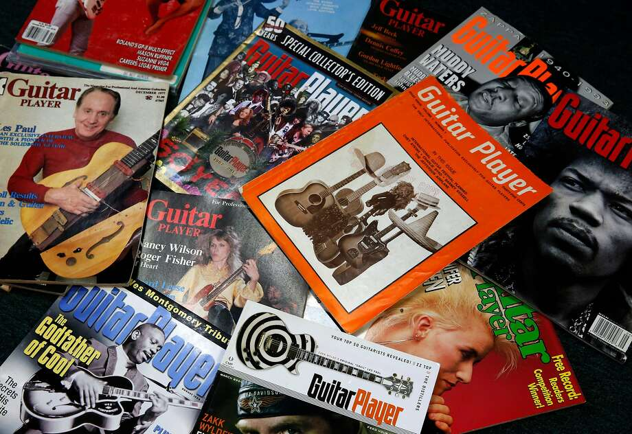 Back issues of Guitar Player magazine, including the first issue from 1967 (center), are displayed. Photo: Paul Chinn, The Chronicle