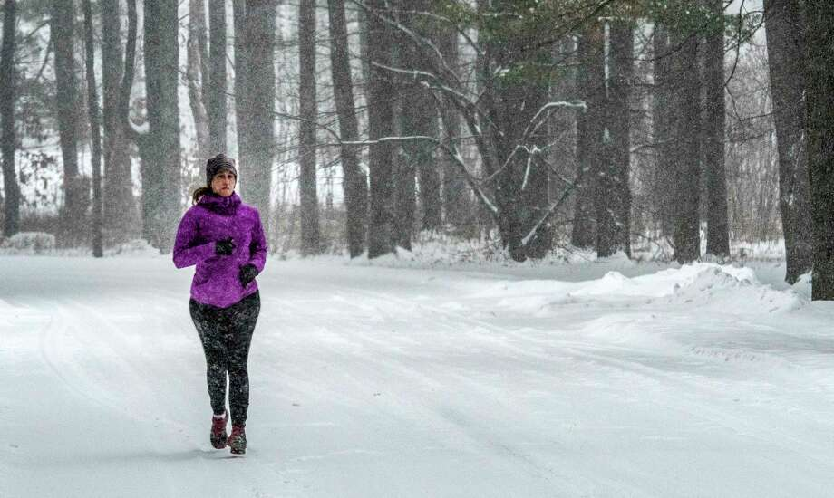 Carrie Robinson of Ballston Spa is out for a jog in the fresh snow at the Saratoga State Park Friday Dec 22, 2017 in Saratoga Springs, N.Y.  (Skip Dickstein/ Times Union) Photo: SKIP DICKSTEIN, Albany Times Union