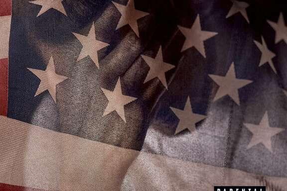 "This photo provided by Interscope Records shows rapper Eminem new album, ""Revival."" On ""Revival,"" his ninth studio album, Eminem makes himself relevant with his smart rhymes, which is refreshing in the age of ""mumble rap."" The album artwork is of the American flag, with race and President Donald Trump being recurring topics throughout the 19 tracks. (Interscope Records via AP)"