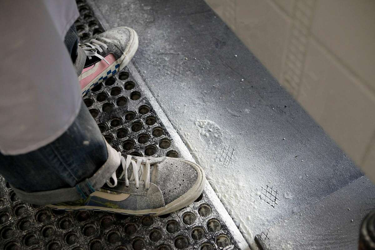 The shoes of Anthony Mangieri, who has a wheat allergy, are dusted with flour as he makes pizzas at his restaurant Un Pizza Napoletana in San Francisco CA, Wednesday May 14, 2014.
