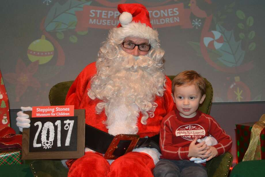 Kids and families sat and took photos with Santa at Stepping Stones Museum for Children in Norwalk on December 22, 2017. Were you SEEN? Photo: Vic Eng / Hearst Connecticut Media Group