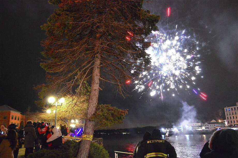 The sky was aglow over the Saugatuck River near the Westport Library during First Night Westport in 2016. Fireworks will be offered this New Year's Eve at 8 p.m. Photo: Jarret Liotta / For Hearst Connecticut Media / Westport News Freelance