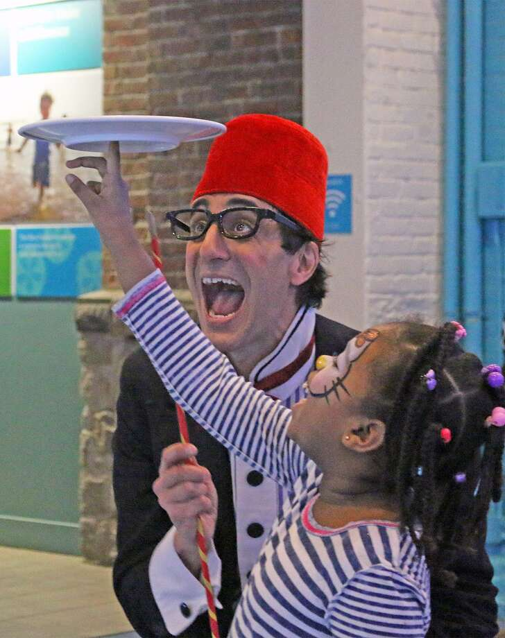 "Featured at the Maritime Aquarium New Year's Eve party, Dec. 31, from 11 a.m. to 3 p.m., will be ""bubble-ologist"" Kim Winslow, strolling family comedy and juggling by Peter Straus, above, and strolling magician Greg Dubin. Photo: Maritime Aquarium / Contributed Photo"