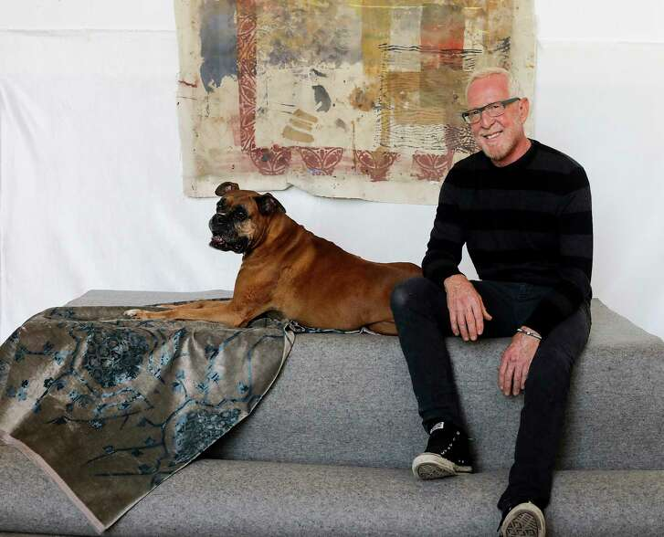 Rusty Arena, in his studio with his dog, Rufus, creates fabrics for the interior design industry. His current project is a line of Turkish-inspired velvet pillows for Restoration Hardware.