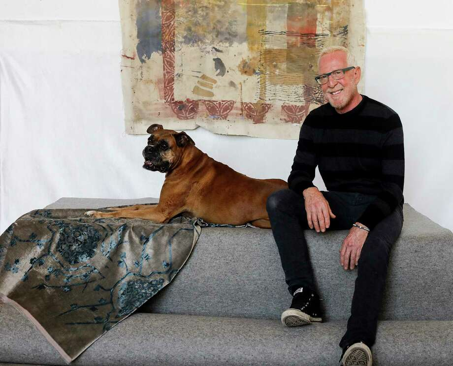 Rusty Arena, in his studio with his dog, Rufus, creates fabrics for the interior design industry. His current project is a line of Turkish-inspired velvet pillows for Restoration Hardware. Photo: Elizabeth Conley, Houston Chronicle / © 2017 Houston Chronicle