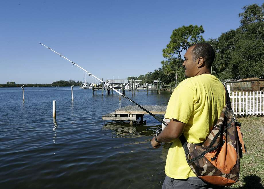 Anthony Stansbury fishes on the Anclote River in Tarpon Springs, Fla. When he moved near the Anclote River last year, he was unaware that the neighborhood is on the list of the nation's most polluted places. Photo: Chris O'Meara, Associated Press
