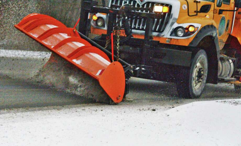 A NYSDOT snow plow clears Albany Shaker Road near the airport Friday Dec. 22, 2017 in Colonie, NY.   (John Carl D'Annibale / Times Union) Photo: John Carl D'Annibale, Albany Times Union / 20042484A
