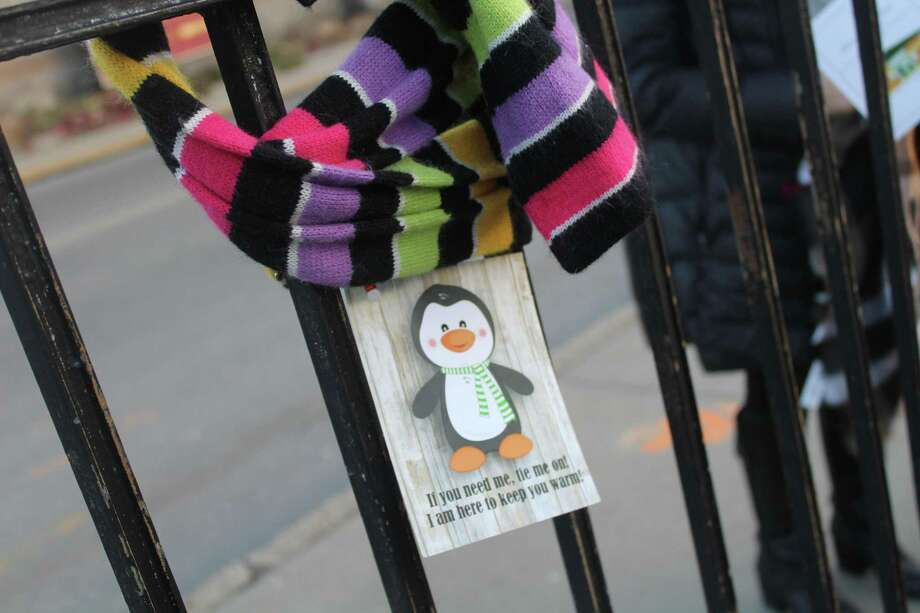 Staff from the Community Health & Wellness Center in Torrington spread warmth in the form of scarves, free for the taking, on fenceposts and street signs near the downtown area earlier this week. Each scarf has a tag inviting someone to take it. Photo: Photo By Patricia Martin