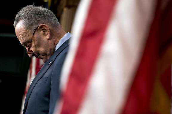 Senate Minority Leader Sen. Chuck Schumer of N.Y., attends a news conference on Capitol Hill in Washington, Thursday, Dec. 21, 2017, to review the Republican agenda this past year. (AP Photo/Andrew Harnik)