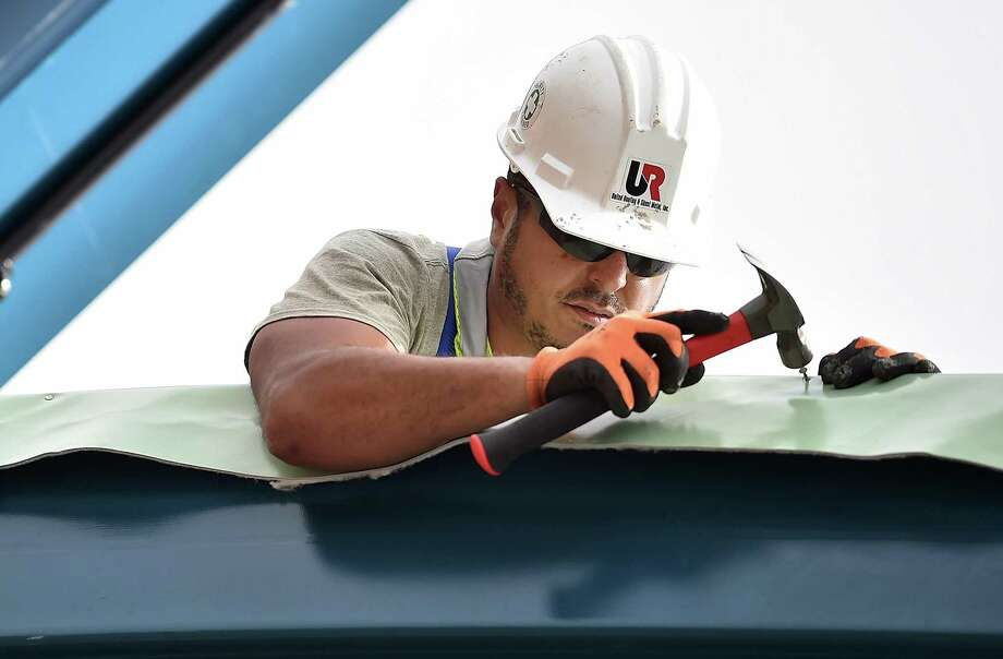 On-again, off-again spring showers have extended this year's wet season in the Bay Area, something which has also upped the number of calls for repairs local roofers are receiving. Photo: Catherine Avalone / Catherine Avalone/New Haven Register / Catherine Avalone/New Haven Register