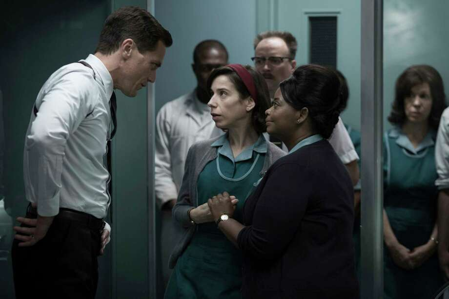 """This image released by Fox Searchlight Pictures shows Michael Shannon, from left, Sally Hawkins and Octavia Spencer in a scene from the film, """"The Shape of Water."""" Guillermo del Toro's Cold War fantasy tale is the leading nominee at the Critics' Choice Awards. It received 14 nominations, including for best picture, best actress for Sally Hawkins and best director for del Toro. (Fox Searchlight Pictures via AP) ORG XMIT: NYET242 Photo: Kerry Hayes / © 2017 Twentieth Century Fox Film Corporation All Rights Reserve"""