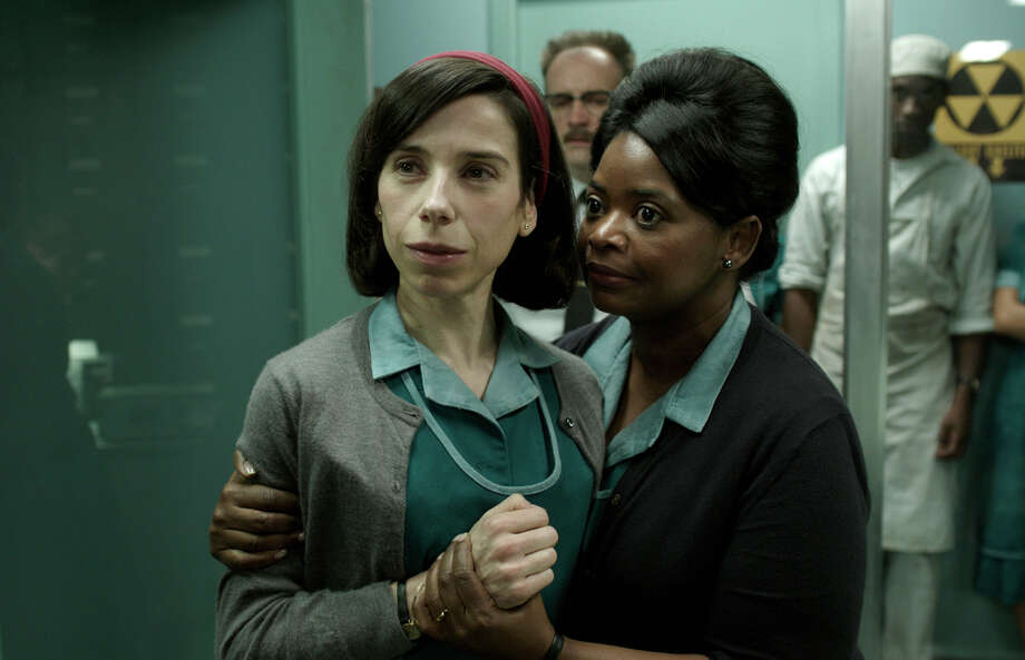 """This image released by Fox Searchlight Pictures shows Sally Hawkins, left, and Octavia Spencer in a scene from the film """"The Shape of Water."""" On Monday, Dec. 11, 2017, Hawkins was nominated for a Golden Globe for best actress in a motion picture drama for her role in the film. The 75th Golden Globe Awards will be held on Sunday, Jan. 7, 2018 on NBC. (Fox Searchlight Pictures via AP) ORG XMIT: NYET121 Photo: Fox Searchlight Pictures / © 2017 Twentieth Century Fox Film Corporation All Rights Reserve"""