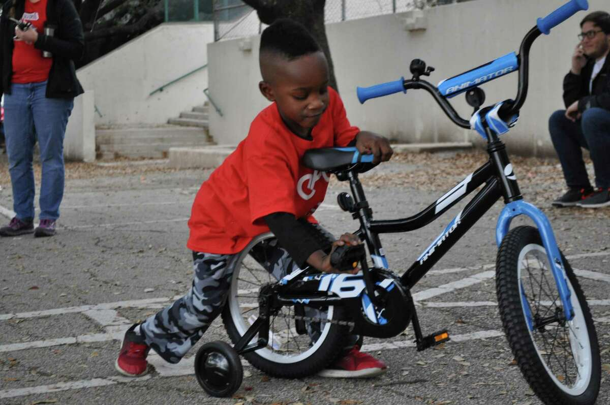Jayden Griffin, 5, checks out his new bike, which he built through the program, Earn-A-Bike.