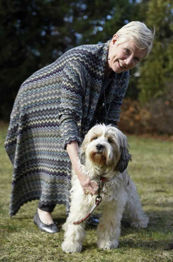 Ann Lockyer poses with her Tibetan Terriers, Sissy, in her backyard in Greenwich, Conn. Wednesday, Dec. 20, 2017. The day she was rescued from Greenville, S.C., Sissy escaped and was lost in town for 10 days before finally being found in Harrison, N.Y. Photo: Tyler Sizemore / Hearst Connecticut Media / Greenwich Time