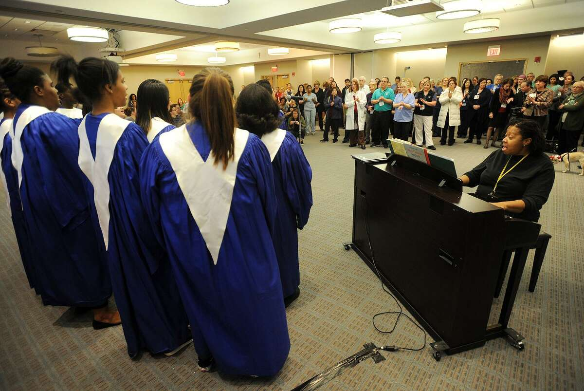 Sheena Graham leads the Harding High School Gospel Choir in a holiday concert at St. Vincent's Medical Center in Bridgeport, Conn. on Thursday, November 30, 2017.