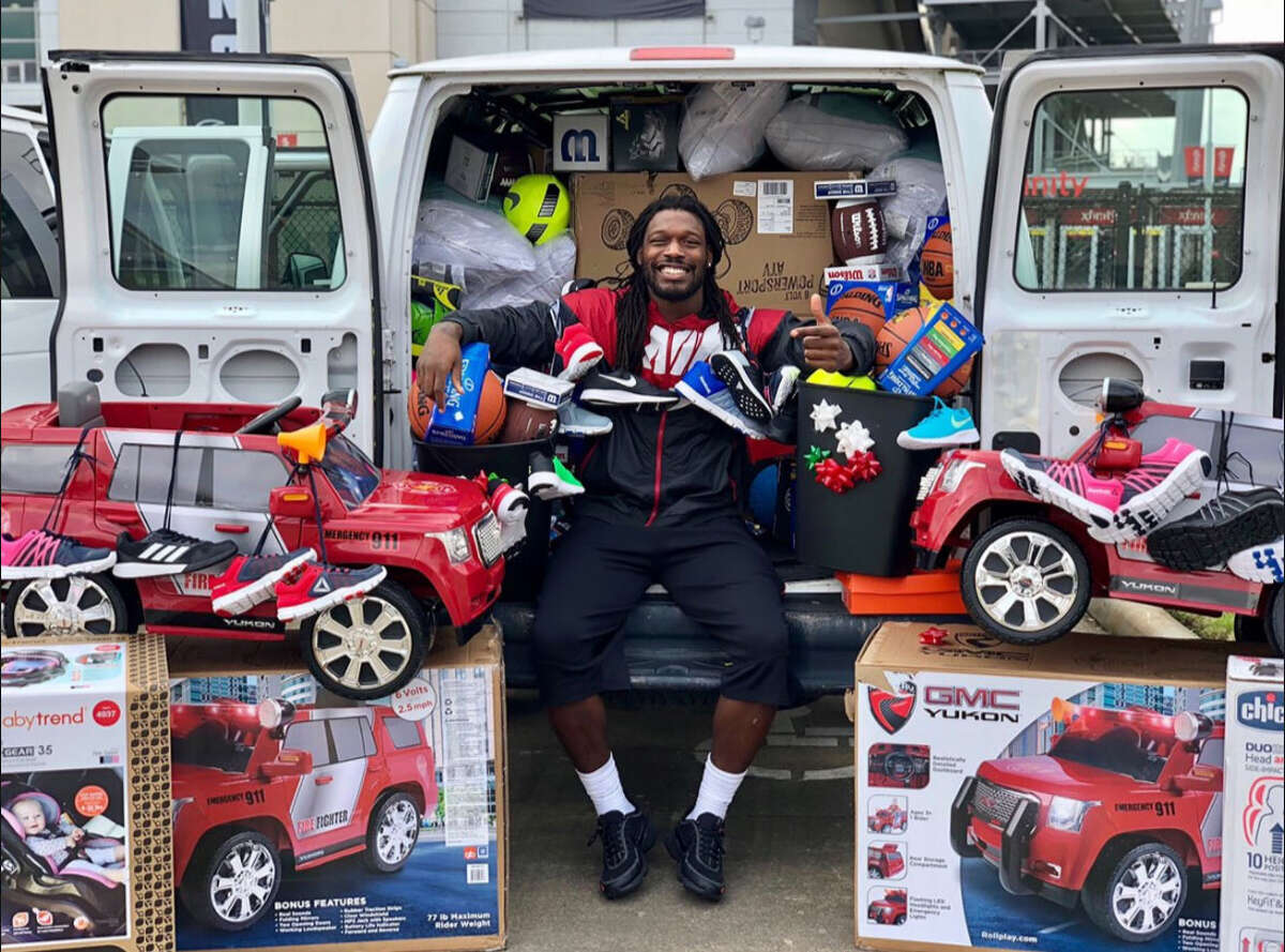 Houston Texans defensive end Jadeveon Clowney says he will fill the trash cans Jaguars fans sent him with these toys that he will donate to deserving families around Houston.