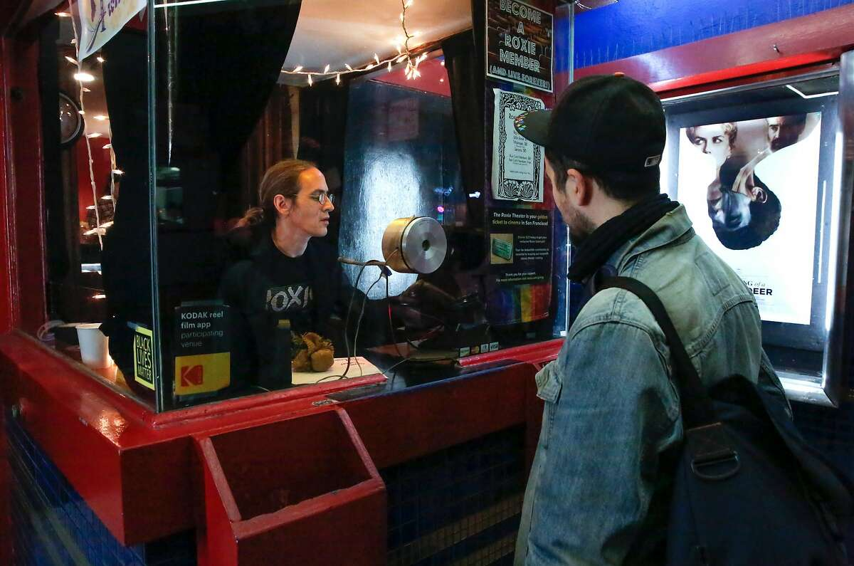 Kyle Griffin sells a ticket to Rob THomas to the evening show at the Roxie Theater located on 16th st. in the Mission neighborhood in San Francisco, Ca. seen on Wed. December 20, 2017.