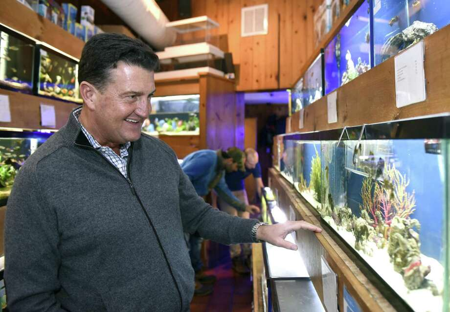 Owner Rob Bray shows fish in aquariums at House of Fins in Greenwich, Conn. Monday, Dec. 18, 2017. House of Fins carries the finest and rarest fish, coral and invertebrates and includes its services include retail sales, custom aquarium installation and routine maintenance. Photo: Tyler Sizemore / Hearst Connecticut Media / Greenwich Time