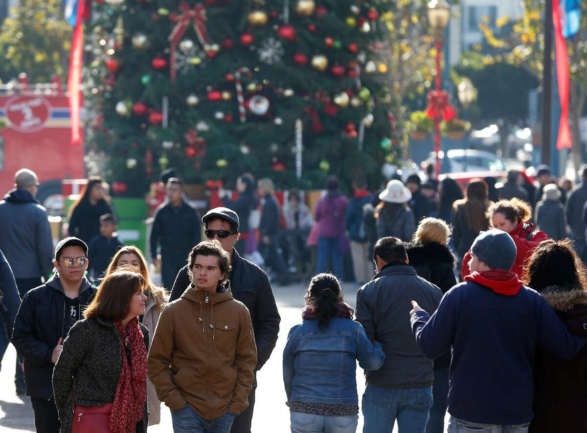 Guests stroll through Pier 39 in San Francisco, Calif. on Friday, Dec. 22, 2017. FBI officials have taken a person into custody who, authorities say, was planning a terrorist attack at the popular tourist destination on Christmas Day.