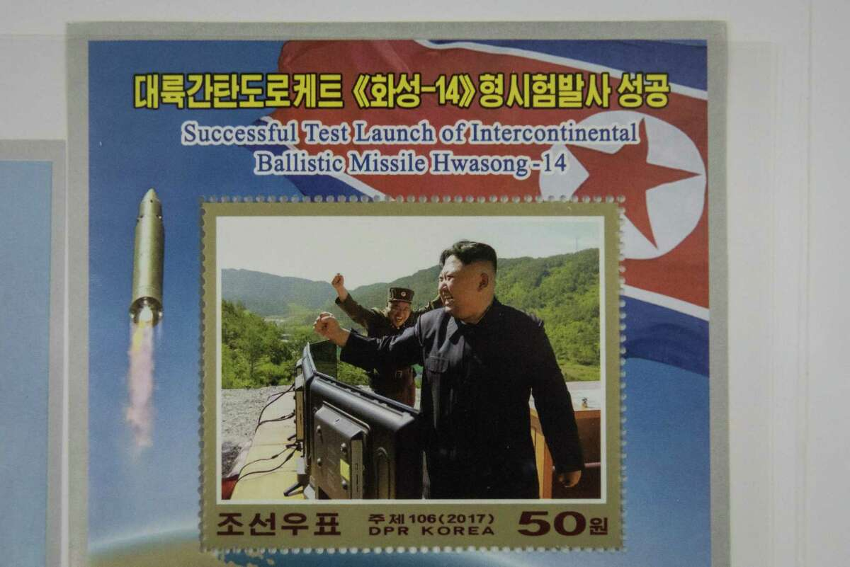 A commemorative stamp featuring an image of North Korean leader Kim Jong-Un celebrating the launch of a Hwasong-14 Intercontinental Ballistic Missile (ICBM), is displayed at a shop in central Pyongyang this month.