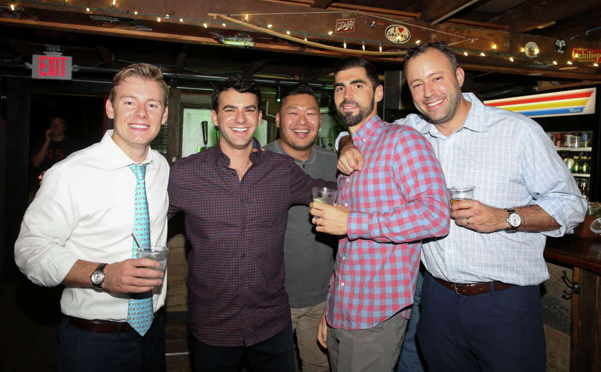 Austin Alvis, form left, Zach Wolf, Simon Ha, James Fitch and Dan Braun pose for a photo at Bobcat Teddy's Ice House on Thursday, Dec. 21, 2017, in Houston. Alvis and his wife, Holly Smith Alvis, are partners of the ice house.