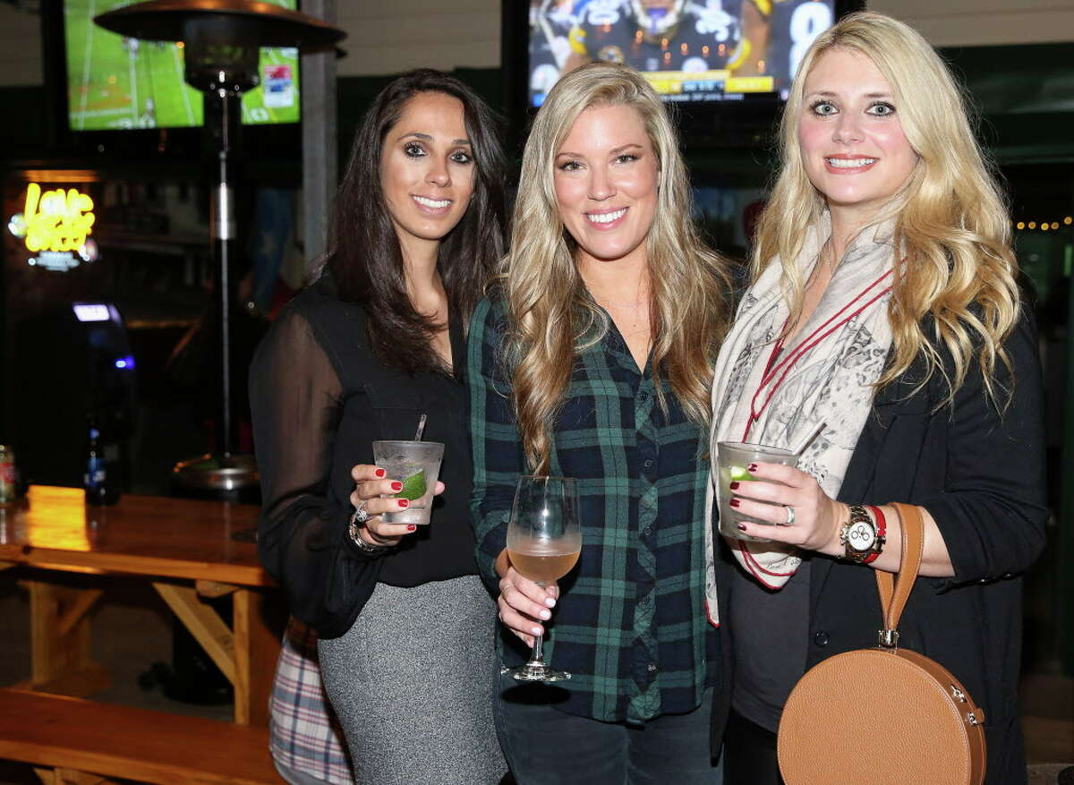 Katherine Poncik, from left, Holly Smith Alvis, and Christine Falgout pose for a photo at Bobcat Teddy's Ice House on Thursday, Dec. 21, 2017, in Houston. Holly Smith Alvis, and her husband, Austin Alvis, are partners of the ice house.