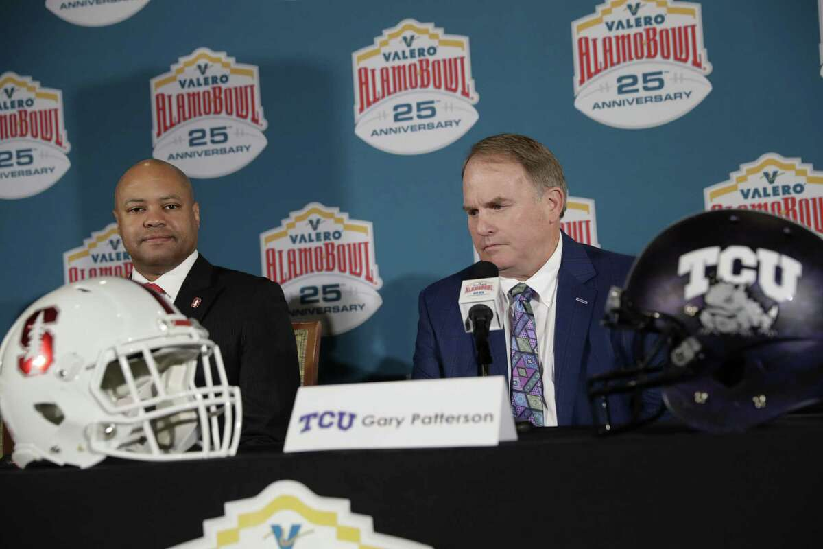 Stanford head coach David Shaw, left, and TCU head coach Gary Patterson, right, take part in a news conference Dec. 7 to publicize the Alamo Bowl NCAA college football game in San Antonio. TCU and Stanford will play in the Alamo Bowl Dec. 28. The organization that stages the game has pledged $1 million in scholarships.