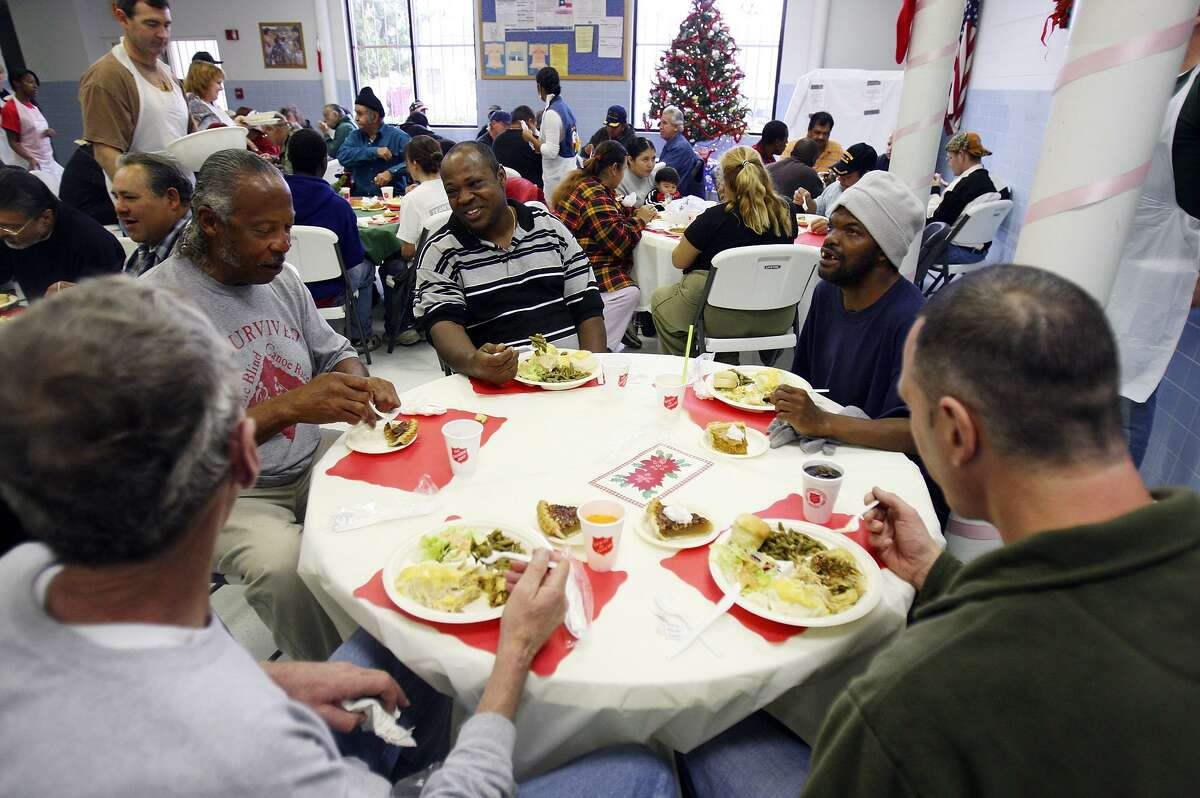 Homeless people enjoy a turkey meal at the San Antonio Salvation Army on Christmas Day 2008. New Year's is a great time to resolve to help people, whether through time or money or both.