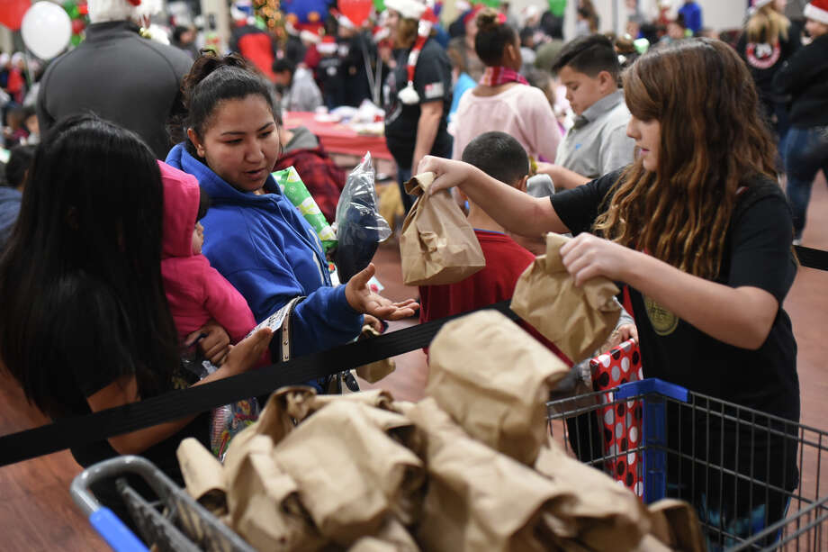 Families receive presents at the annual Christmas lunch on Dec. 22, 2017, at the Midland Soup Kitchen. James Durbin/Reporter-Telegram Photo: James Durbin