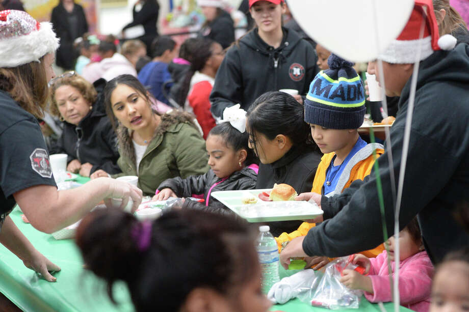 Families dine together at the annual Christmas lunch on Dec. 22, 2017, at the Midland Soup Kitchen. James Durbin/Reporter-Telegram Photo: James Durbin
