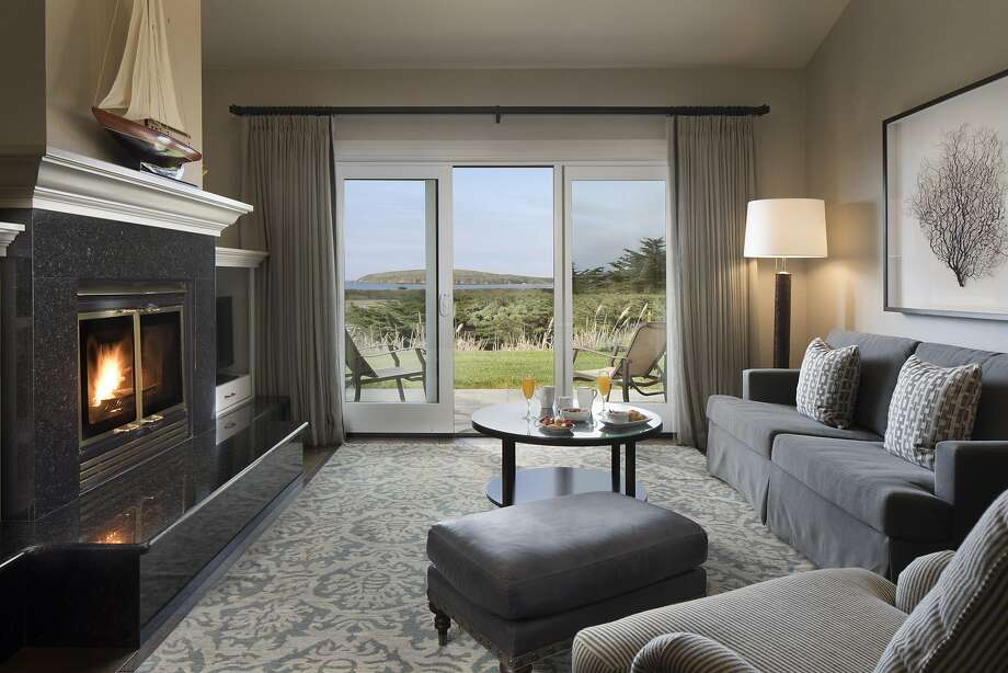 The living rooms in the updated Ocean Club Suites in Bodega Bay Lodge offer flat-screen TVs and gas fireplaces as well as views of Bodega Head. Photo: Bodega Bay Lodge