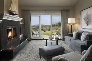 The living rooms in the updated Ocean Club Suites in Bodega Bay Lodge offer flat-screen TVs and gas fireplaces as well as views of Bodega Head.