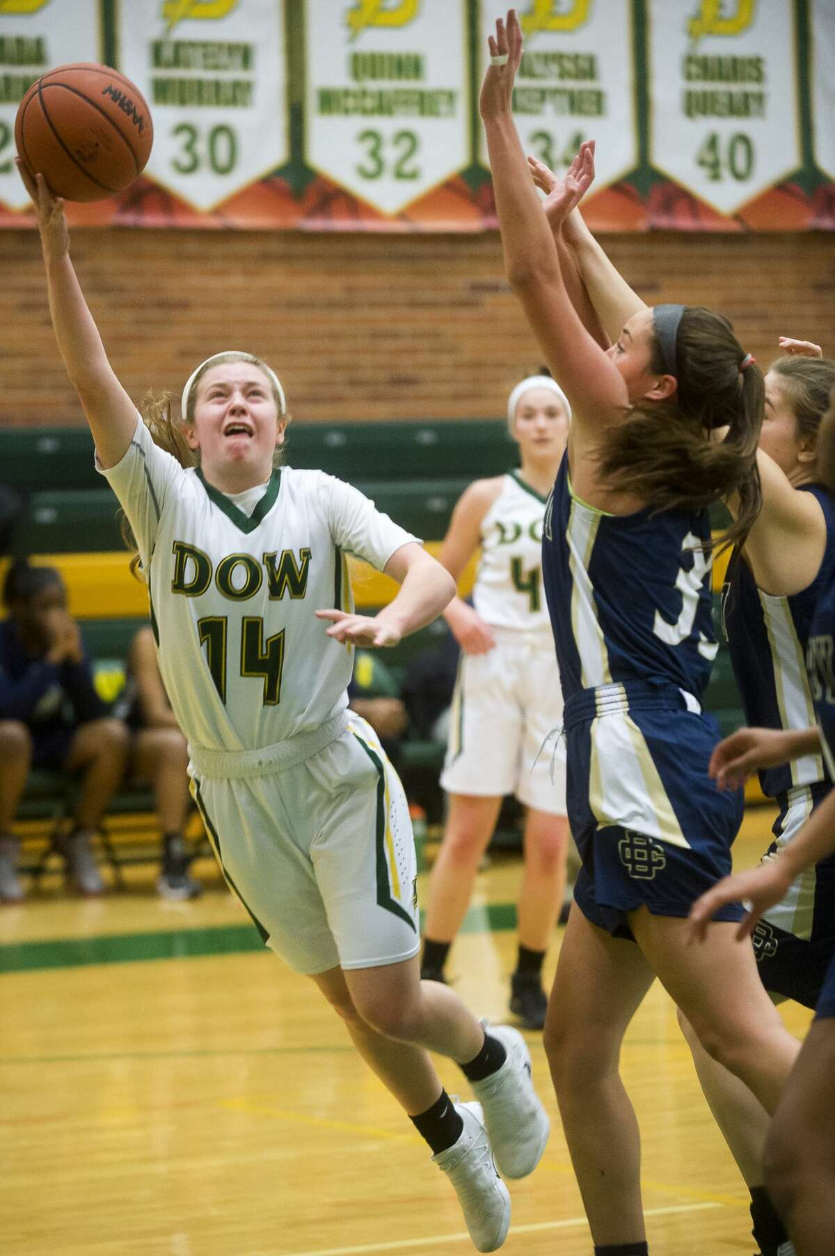 Dow junior Molly Davis takes a shot during the Chargers' game against Detroit Country Day on Friday, Dec. 22, 2017 at H. H. Dow High School. (Katy Kildee/kkildee@mdn.net)