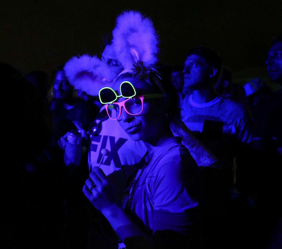 A Houston Whatever Fest participant wears bunny ears and glowing glasses to the concert Saturday, April 1, 2017, in Houston.