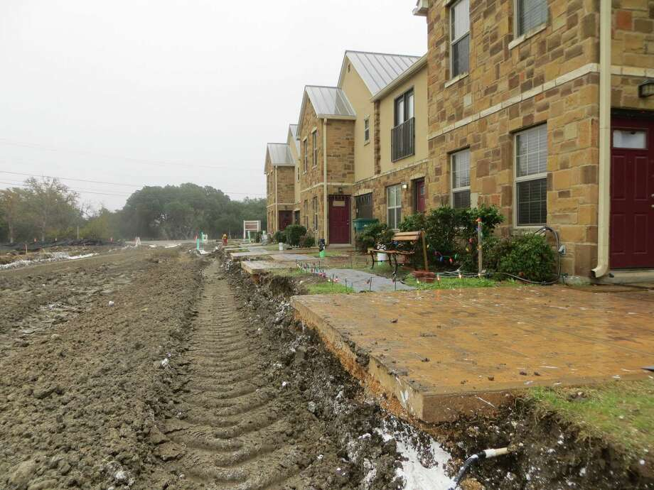 Residents of Herff Village Townhomes in Boerne have been forced to park on nearby streets since the final stage of road work began earlier this month. The white substance is lime that is mixed with the dirt to help stabilize the road base. Photo: Zeke MacCormack /San Antonio Express-News / San Antonio Express-News