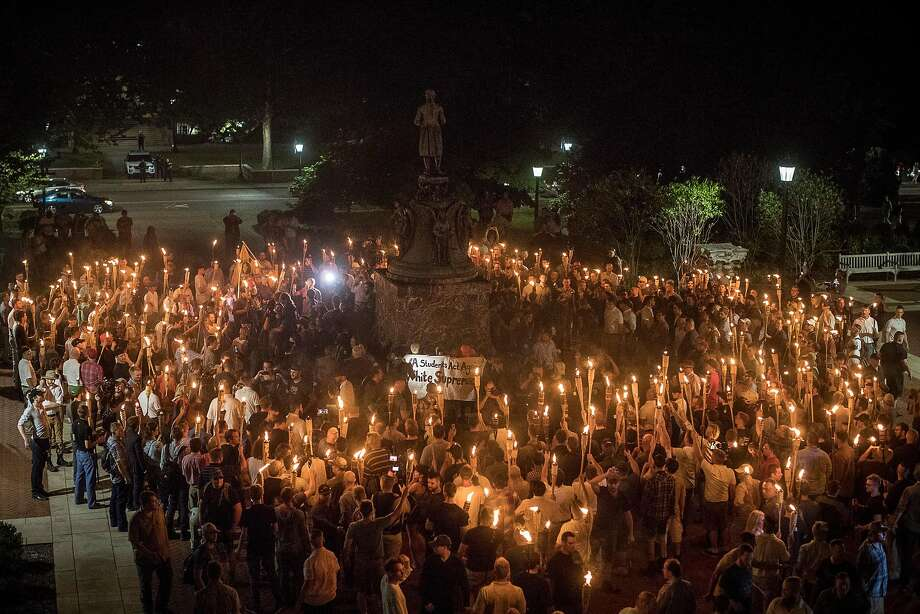 Neo-Nazis and white supremacists rally on the grounds of the University of Virginia in Charlottesville on Aug. 11. Two days of protests left one person dead and dozens injured. Photo: EDU BAYER, NYT