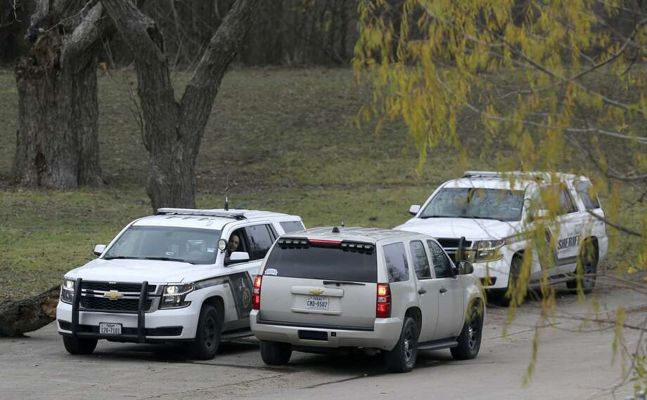 Law enforcement sits Friday December 22, 2017 in front of the Pecan Grove Maufactured Home Community in Schertz, Texas where six-year-old Kameron Prescott was shot. Prescott was shot while inside his home in the 100 block of Peach Lane. Four Bexar County deputies had been chasing a wanted felon in the area, and they opened fire on her as she tried to break into Prescott's home. The woman, who has not been identified, was killed. Photo: John Davenport, STAFF / San Antonio Express-News / ©John Davenport/San Antonio Express-News