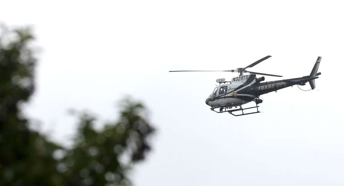 A Department of Public Safety helicopter flies Friday December 22, 2017 over the Pecan Grove Maufactured Home Community in Schertz, Texas where six-year-old Kameron Prescott was shot. Prescott was shot while inside his home in the 100 block of Peach Lane. Four Bexar County deputies had been chasing a wanted felon in the area, and they opened fire on her as she tried to break into Prescott's home. The woman, who has not been identified, was killed.