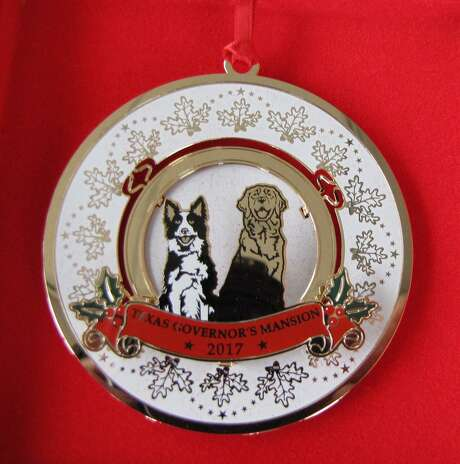 The 2017 Texas Governor's Mansion Christmas Ornament features the new official state china with the Texas Oak pattern and includes the Abbotts' dogs, golden retriever blend Pancake and their late, beloved border collie, Oreo, who died this fall. Photo: Peggy Fikac/Staff