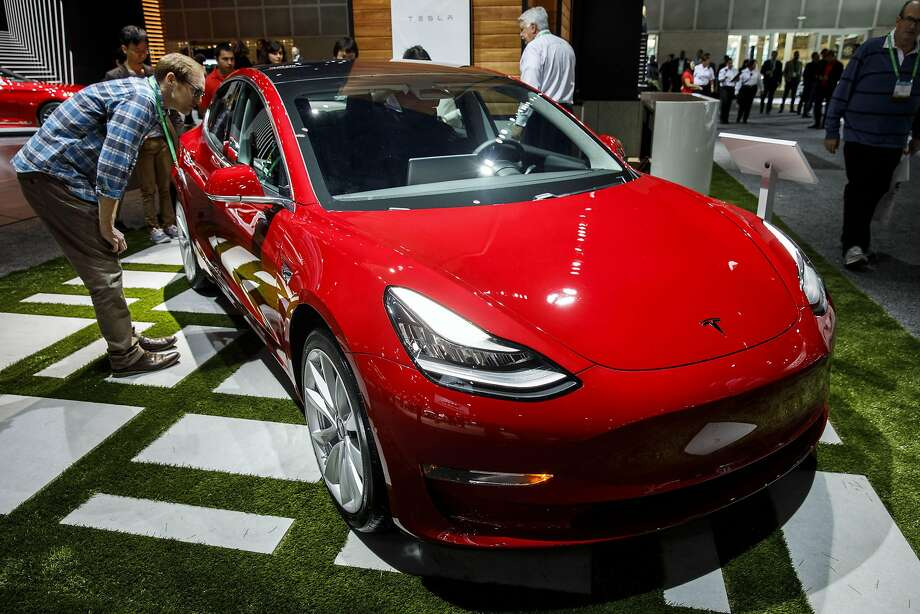 A Tesla Model 3 electric sedan on display at a November, 2017 auto show. Tesla confirmed Friday that the company has begun Model 3 deliveries to reservation holders who are not Tesla employees. Photo: Patrick T. Fallon, Bloomberg