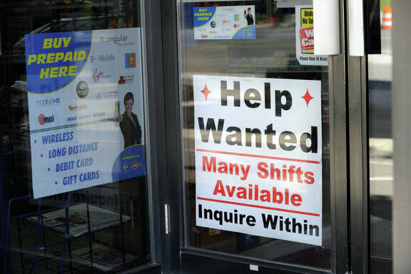 A help wanted sign hangs on the entrance to a Citgo Station on Route 202 in New Milford, Tuesday, Sept. 21, 2010.
