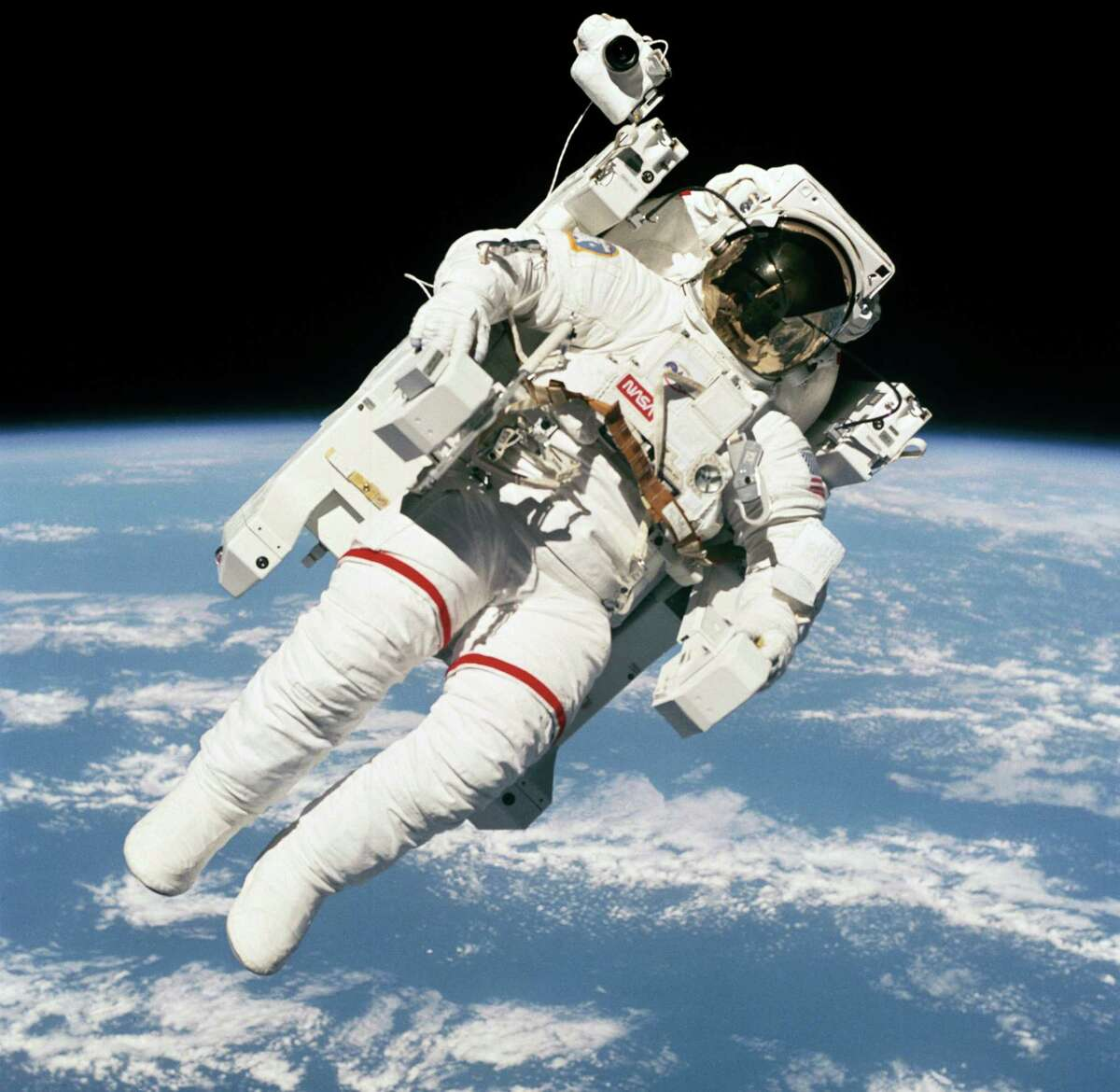 Astronaut Bruce McCandless II, STS-41-B mission specialist, uses his hands to control his movement during the first-ever spacewalk that didn't use restrictive tethers and umbilicals.