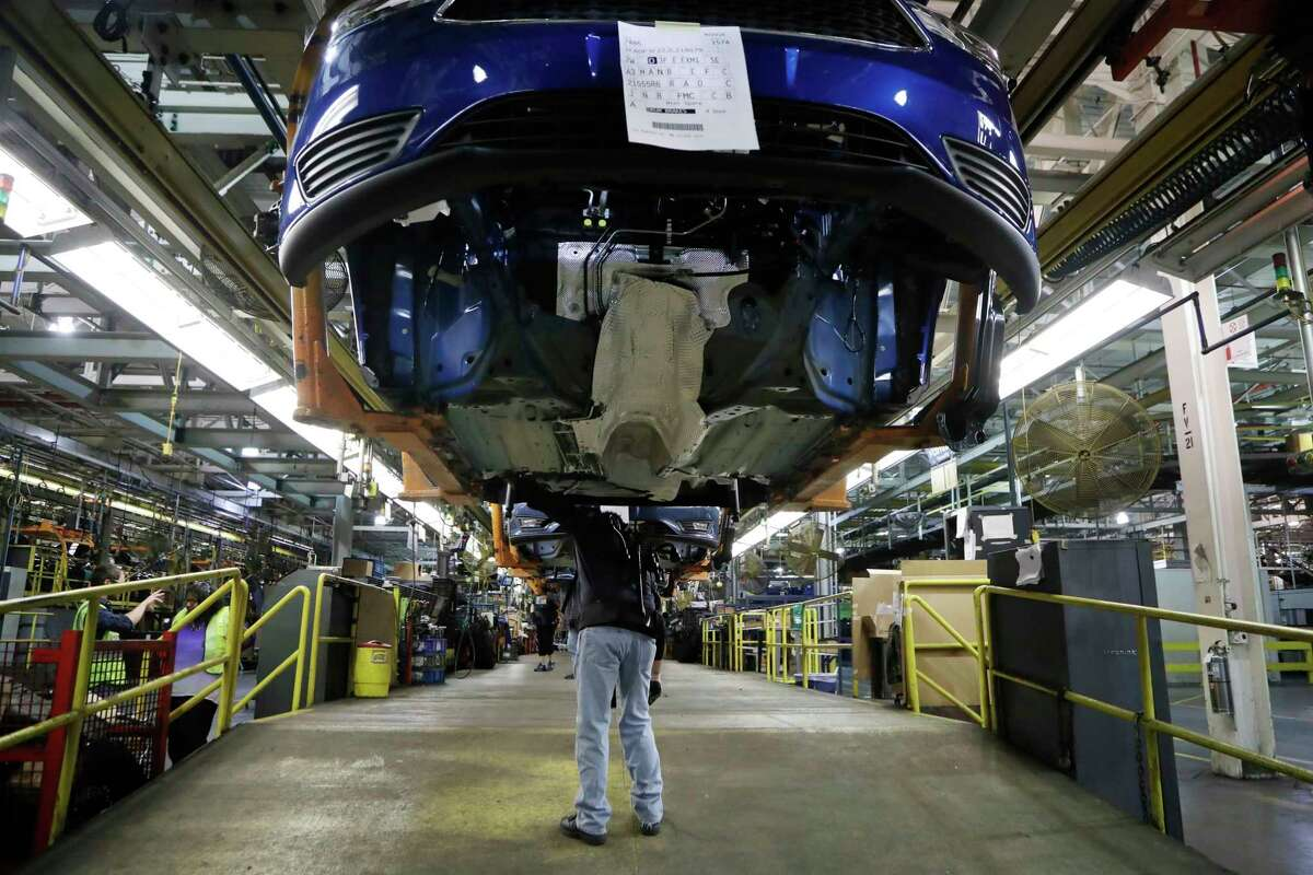 Paul Collins works on a Ford Focus in Wayne, Mich. Orders for long-lasting manufactured goods rose last month by 1.3 percent.
