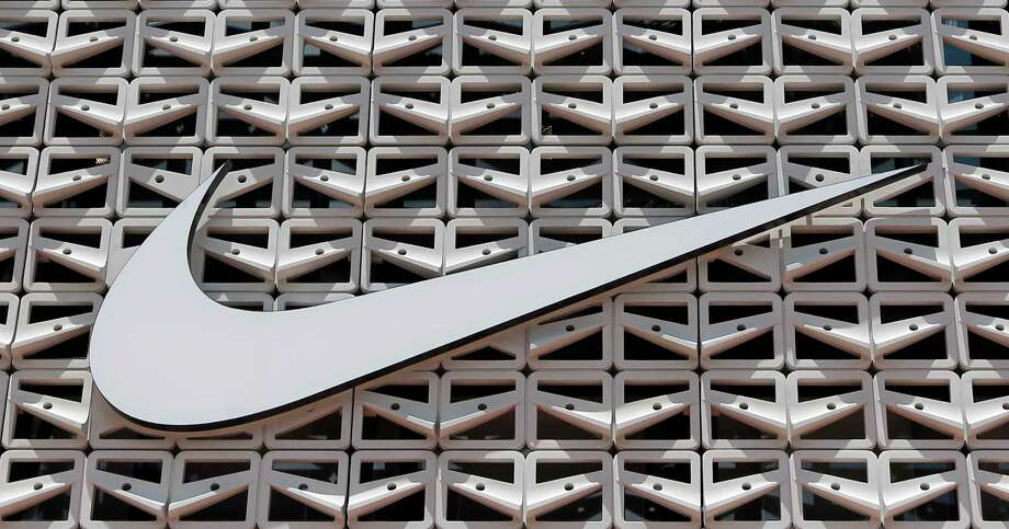 This Tuesday, Aug. 8, 2017, photo shows the Nike logo at a store in Miami Beach, Fla. Nike Inc. reports earnings Thursday, Dec. 21, 2017. (AP Photo/Alan Diaz) Photo: Alan Diaz / Copyright 2017 The Associated Press. All rights reserved.