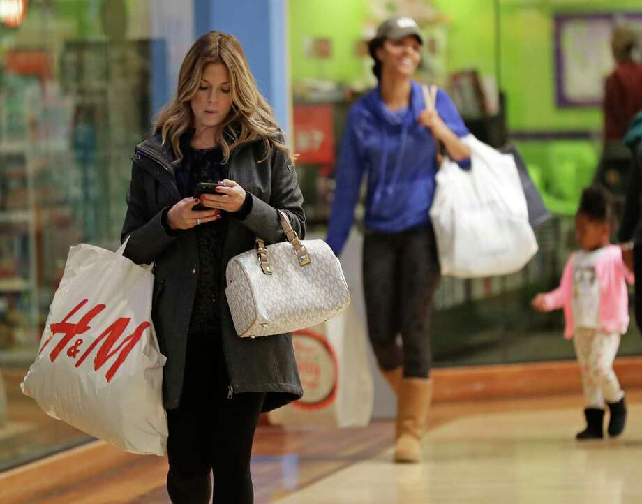 This shopper was at a mall in Concord, N.C., this week. Holiday spending is surging, a report says. Photo: Chuck Burton, STF / Copyright 2017 The Associated Press. All rights reserved.