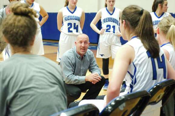 Friendswood basketball coach Daron Scott  speaks to his team during a break against Clear Falls Friday at Friendswood High School.