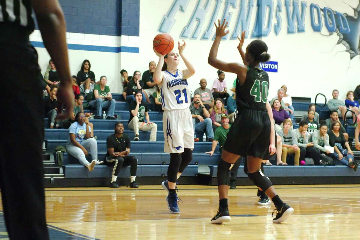 Friendswood's Kinsey Cole (21) puts up over shot Clear Falls' Anita Parrott (40) Friday at Friendswood High School.