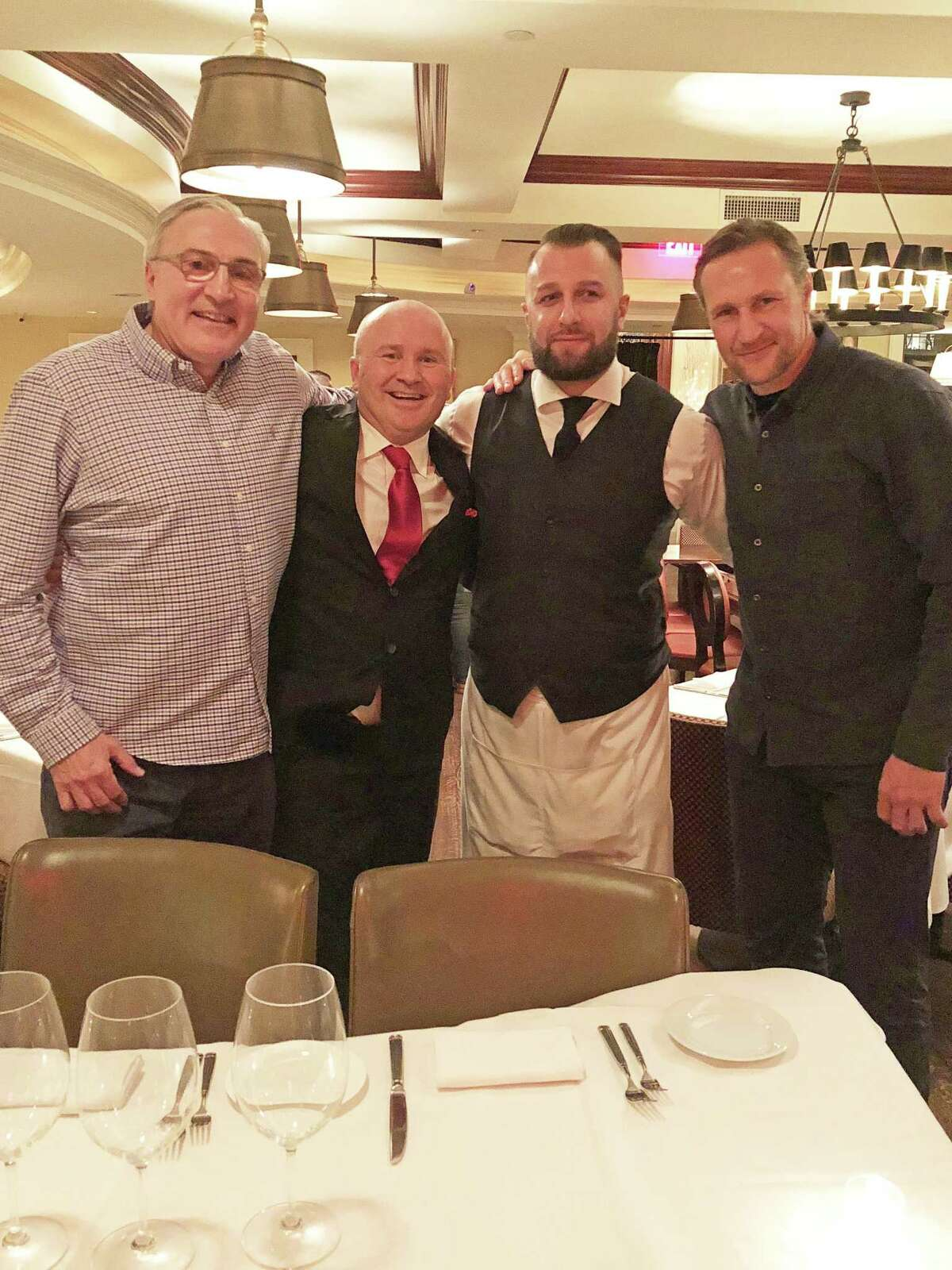 From left: Former hockey great John Tonelli with Tony Capasso, Gabriele's maitre'd and managing partner; Mentor Berisha and former Russian hockey star Alexei Kovalev at Gabriele's Italian Steakhouse on Dec. 10.