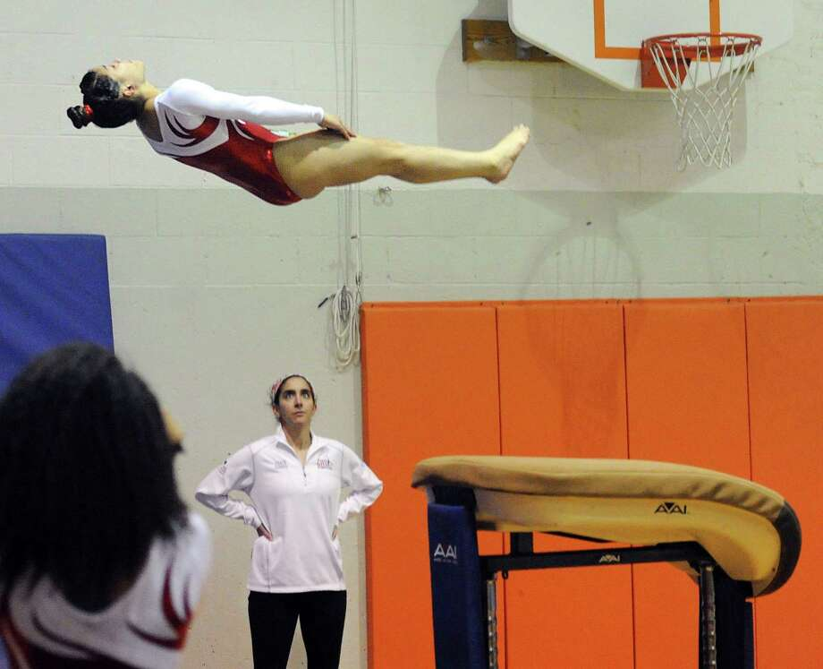 Greenwich's Adnerys De Jesus vaults during the gymnastics meet against Staples Friday at YWCA of Greenwich. Photo: Bob Luckey Jr. / Hearst Connecticut Media / Greenwich Time
